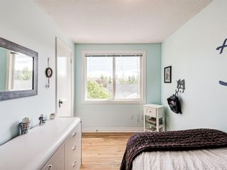 Photo 25: 63 Amiens Crescent in Calgary: Garrison Woods Semi Detached for sale : MLS®# A1098899