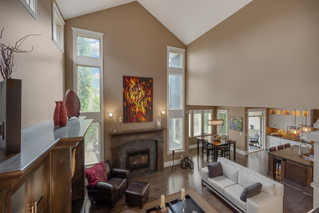 Welcome to Westpointe Estates!  The great room with 22 feet ceilings,  massive built in cabinetry, and Regency fireplace.