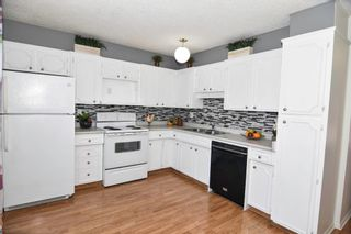 Photo 11: 31 9908 Bonaventure Drive SE in Calgary: Willow Park Row/Townhouse for sale : MLS®# A1065621