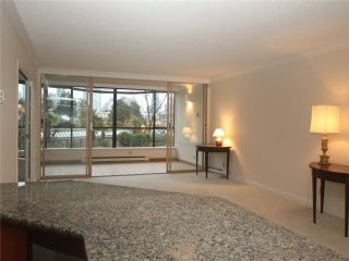 """Photo 2: 102 1470 PENNYFARTHING Drive in Vancouver: False Creek Condo for sale in """"HARBOUR COVE"""" (Vancouver West)  : MLS®# V1038676"""