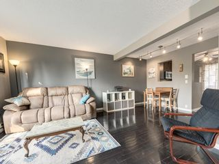 Photo 3: 8 220 ERIN MOUNT Crescent SE in Calgary: Erin Woods Row/Townhouse for sale : MLS®# A1088896