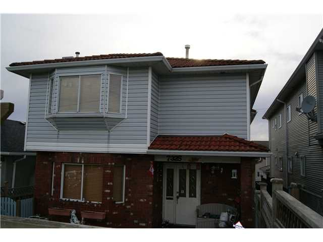 Main Photo: 7327 FRASER Street in Vancouver: South Vancouver 1/2 Duplex for sale (Vancouver East)  : MLS®# V843279