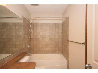Photo 22: 103 WEST POINTE Court: Cochrane House for sale : MLS®# C4042878