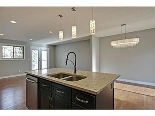 Photo 6: 27 Meadowview Road SW in Calgary: Meadowlark Park Detached for sale : MLS®# A1084197