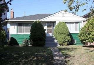 Photo 1: 715 W 61ST Avenue in Vancouver: Marpole House for sale (Vancouver West)  : MLS®# R2209967