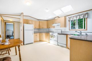 """Photo 2: 64 8254 134 Street in Surrey: Queen Mary Park Surrey Manufactured Home for sale in """"WESTWOOD ESTATES"""" : MLS®# R2597821"""