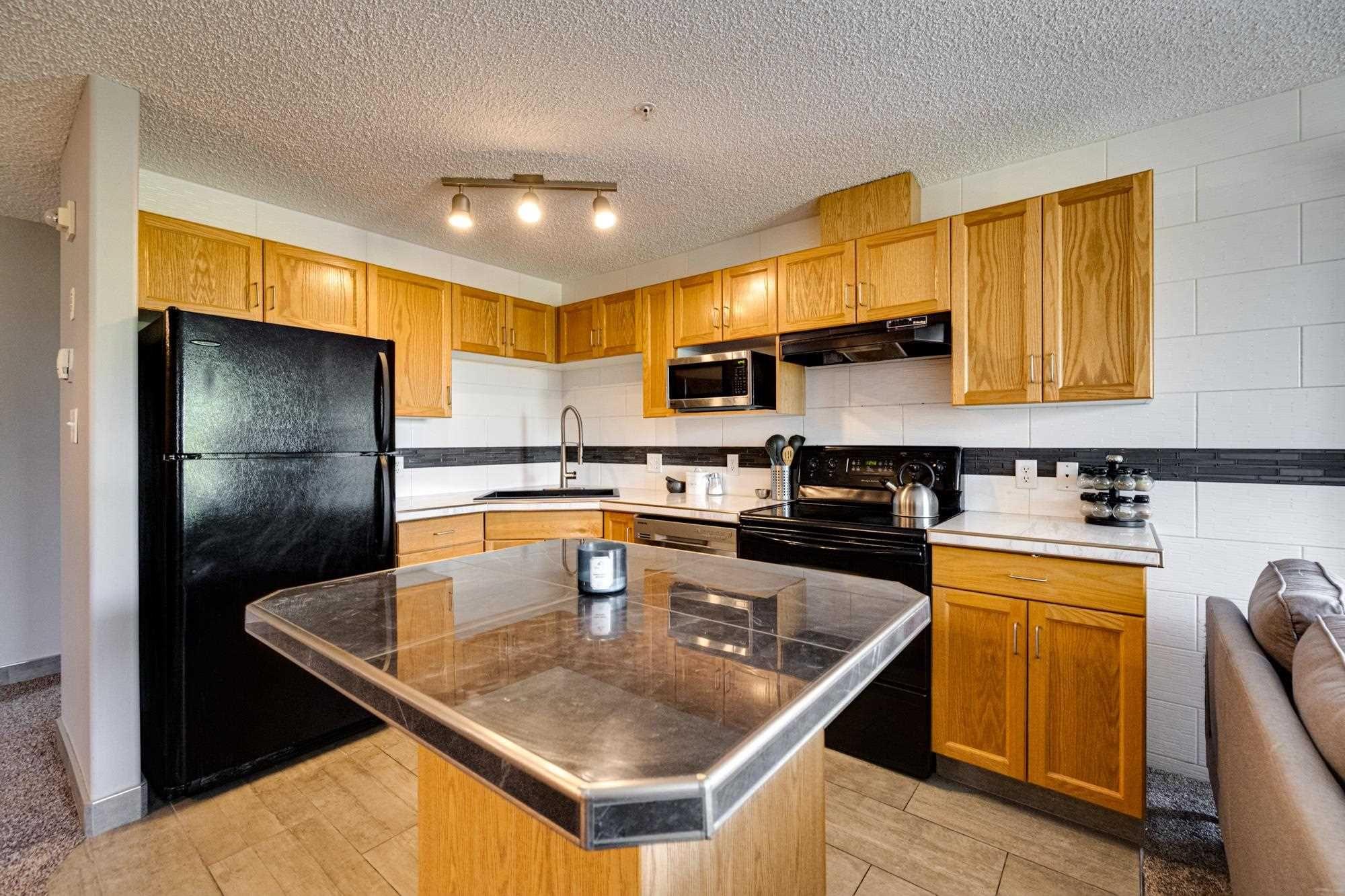 Main Photo: 425 11325 83 Street in Edmonton: Zone 05 Condo for sale : MLS®# E4247636