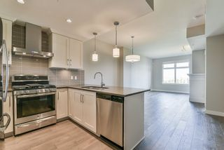 "Photo 3: 410 5011 SPRINGS Boulevard in Delta: Condo for sale in ""TSAWWASSEN SPRINGS"" (Tsawwassen)  : MLS®# R2329912"