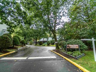 "Photo 1: 210 JAMES Road in Port Moody: Port Moody Centre Townhouse for sale in ""TALL TREE ESTATES"" : MLS®# R2405921"