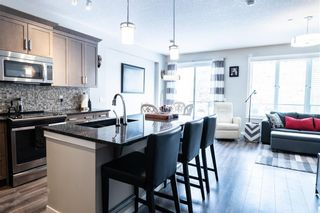 Photo 5: 32 245 Sunset Point: Cochrane Row/Townhouse for sale : MLS®# A1109200