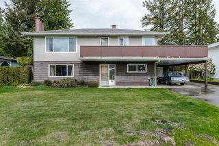 Photo 1: 1801 WOODVALE Avenue in Coquitlam: Central Coquitlam House for sale : MLS®# R2057117