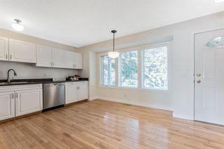 Photo 10: 472 Regal Park NE in Calgary: Renfrew Row/Townhouse for sale : MLS®# A1118290