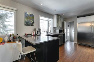 Photo 11: 8207 7 Street SW in Calgary: Kingsland Detached for sale : MLS®# A1080645