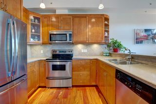 Photo 3: 1403 24 Hemlock Crescent SW in Calgary: Spruce Cliff Apartment for sale : MLS®# A1147232