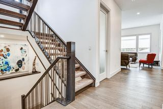 Photo 7: 907 31 Avenue NW in Calgary: Cambrian Heights Detached for sale : MLS®# A1095749