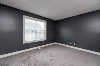 Photo 26: 312 BRIDLEWOOD Lane SW in Calgary: Bridlewood Row/Townhouse for sale : MLS®# A1046866