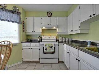 Photo 7: 22 COACHWAY Green SW in Calgary: 4 Level Split for sale : MLS®# C3572923