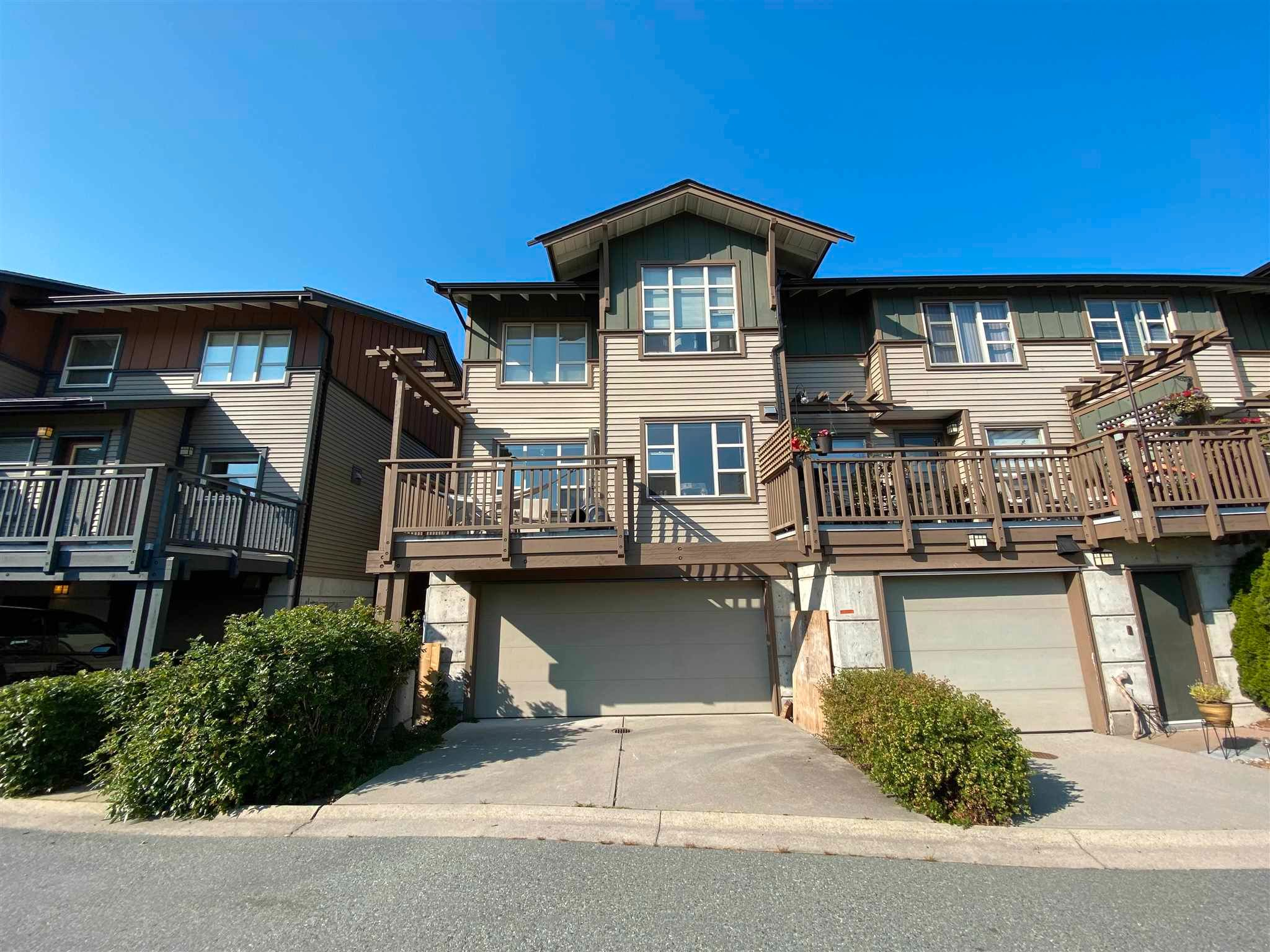 """Main Photo: 1214 VILLAGE GREEN Way in Squamish: Downtown SQ Townhouse for sale in """"TALON AT EAGLEWIND"""" : MLS®# R2599998"""
