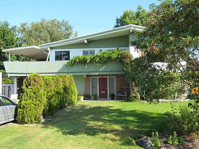 Exterior Front: Super potential in this 2600 square foot home. New roof and huge lot.