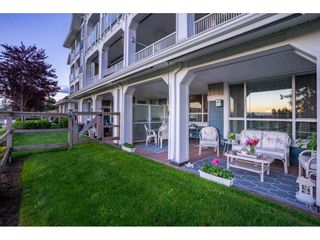 """Photo 6: 209 16380 64 Avenue in Surrey: Cloverdale BC Condo for sale in """"The Ridge at Bose Farms"""" (Cloverdale)  : MLS®# R2589170"""
