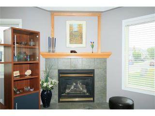 Photo 9: 1 122 BOW RIDGE Crescent: Cochrane House for sale : MLS®# C4073392