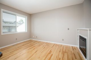 Photo 5: 8 Everridge Gardens SW in Calgary: Evergreen Row/Townhouse for sale : MLS®# A1041120