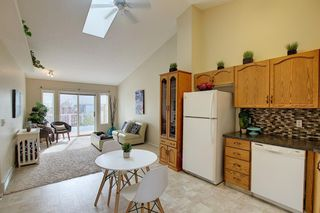 Photo 2: 8 12 Woodside Rise NW: Airdrie Row/Townhouse for sale : MLS®# A1108776