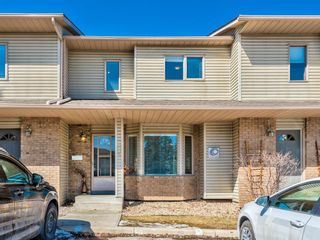 Main Photo: 45 Patina Park SW in Calgary: Patterson Row/Townhouse for sale : MLS®# A1085430