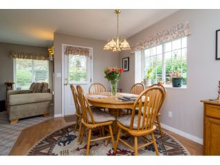 """Photo 9: 18155 60 Avenue in Surrey: Cloverdale BC House for sale in """"CLOVERDALE"""" (Cloverdale)  : MLS®# R2056638"""