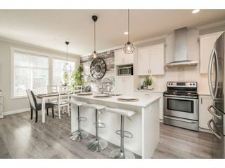 """Photo 9: 13 7138 210 Street in Langley: Willoughby Heights Townhouse for sale in """"Prestwick at Milner Heights"""" : MLS®# R2538094"""