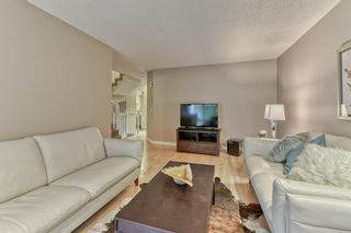 Photo 7: 85 Coachway Gardens SW in Calgary: Coach Hill Row/Townhouse for sale : MLS®# A1110212