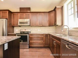 Photo 3: 10 2991 North Beach Dr in CAMPBELL RIVER: CR Campbell River North Row/Townhouse for sale (Campbell River)  : MLS®# 723883