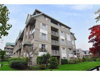 "Photo 1: 209 11609 227TH Street in Maple Ridge: East Central Condo for sale in ""EMERALD MANOR"" : MLS®# V862542"