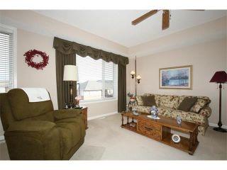 Photo 13: 155 CRAWFORD Drive: Cochrane House for sale : MLS®# C4092224