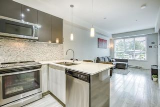 """Photo 12: 205 6468 195A Street in Surrey: Clayton Condo for sale in """"Yale Bloc Building 1"""" (Cloverdale)  : MLS®# R2456985"""