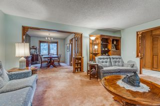 Photo 8: 244 Lake Moraine Place SE in Calgary: Lake Bonavista Detached for sale : MLS®# A1047703