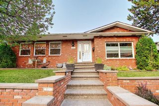 Photo 1: 376 DEERVIEW Drive SE in Calgary: Deer Ridge Detached for sale : MLS®# A1034860