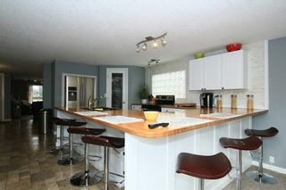 Photo 18: 30 GLENWOOD Crescent: Cochrane House for sale : MLS®# C4110589