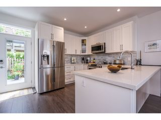 """Photo 11: 97 9989 BARNSTON Drive in Surrey: Fraser Heights Townhouse for sale in """"Highcrest"""" (North Surrey)  : MLS®# R2477034"""