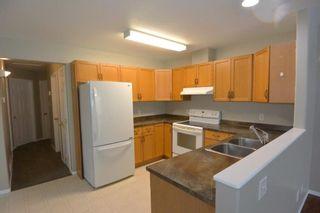 Photo 4: Unit A 3568 3rd Avenue Smithers | Half Duplex