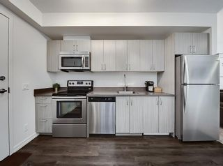 Photo 5: 306 450 8 Avenue SE in Calgary: Downtown East Village Apartment for sale : MLS®# A1095173