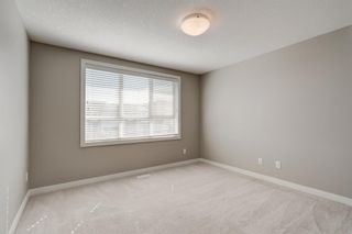 Photo 19: 103 Walgrove Cove SE in Calgary: Walden Row/Townhouse for sale : MLS®# A1145152