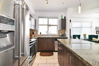 """Photo 7: 204 33545 RAINBOW Avenue in Abbotsford: Central Abbotsford Condo for sale in """"Tempo"""" : MLS®# R2606221"""