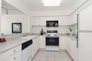 """Photo 2: 403 2288 W 12TH Avenue in Vancouver: Kitsilano Condo for sale in """"CONNAUGHT POINT"""" (Vancouver West)  : MLS®# V1077930"""