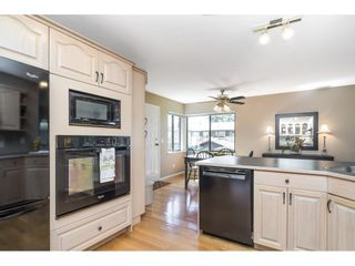 """Photo 11: 6155 131 Street in Surrey: Panorama Ridge House for sale in """"PANORAMA PARK"""" : MLS®# R2556779"""