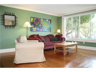 Photo 2: 4960 MOSS Street in Vancouver: Collingwood VE House for sale (Vancouver East)  : MLS®# V899142