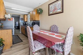 Photo 4: 6728 43 Avenue NE in Calgary: Temple Detached for sale : MLS®# A1092805
