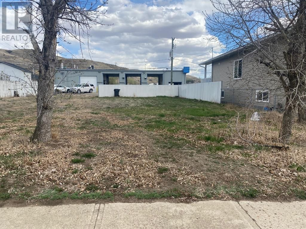 Main Photo: 104 Poplar  Street in Drumheller: Vacant Land for sale : MLS®# A1109169