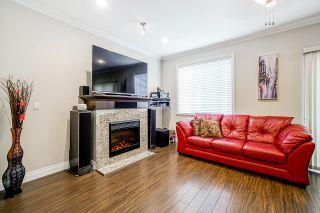 Photo 1: 6882 144 Street in Surrey: East Newton Condo for sale : MLS®# R2608297
