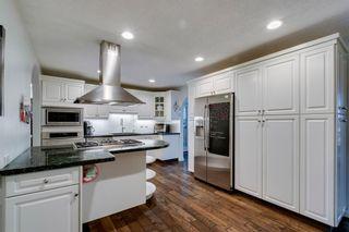 Photo 8: 275 Parkland Crescent SE in Calgary: Parkland Detached for sale : MLS®# A1064121